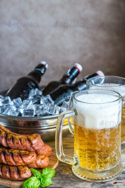 Grilled sausages  and mugs of beer