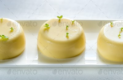Vanilla puddings decorated with fresh mint