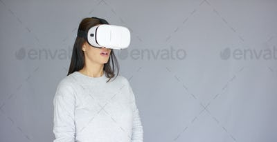 Excited woman watching something on her virtual reality helmet