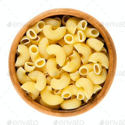 Chifferi pasta in wooden bowl over white