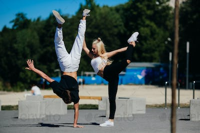 man and woman performing tricks
