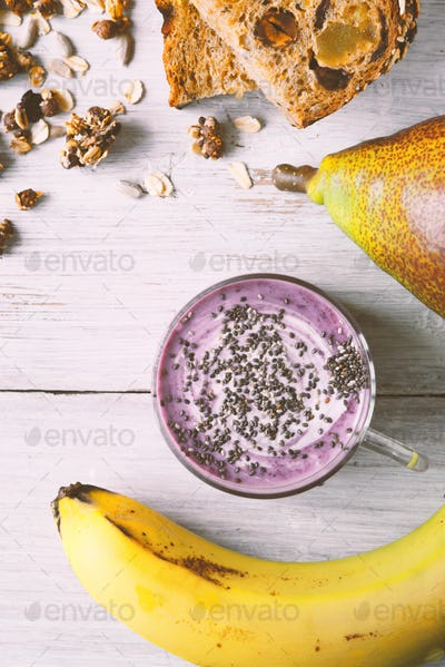 Farm yogurt with chia in a jar, granola, banana