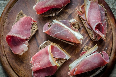 Sandwiches with  italian ham on the wooden board