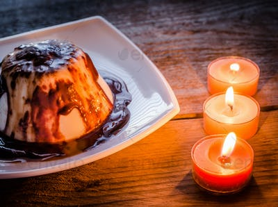 Panna cotta under chocolate sauce