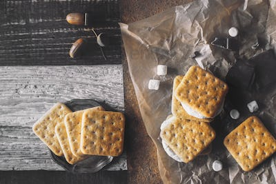 Smores with ingredients on the different background top view