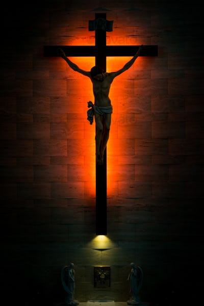 Catholic Christian Crucifix in silhouette, with tabernacle under