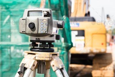 Dumpy automatic level instrument with construction site backgrou