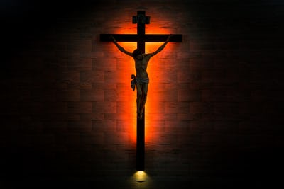 Crucifix of the Catholic Christian in silhouette.
