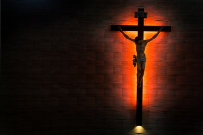 Catholic Christian Crucifix in silhouette flushed right.
