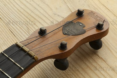 Ukelele banjo head stock