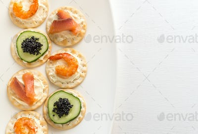 Canape with seafood on the plate