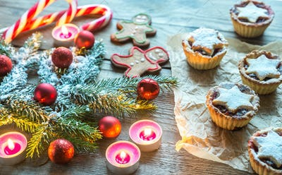 Decorated Christmas tree branch with holiday pastry