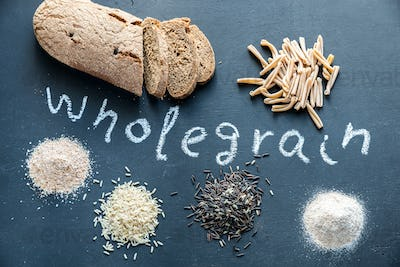 Wholegrain products on the dark wooden background