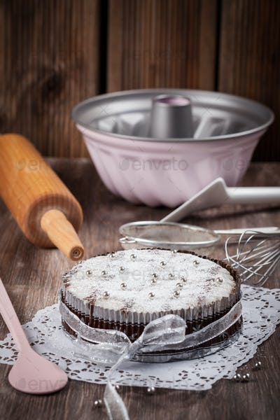 Christmas cake with baking utensils