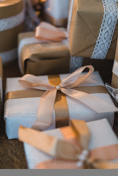 Classy Christmas hand made gifts box presents with brown bows. Selective focus