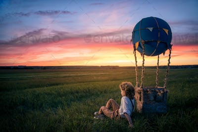 Little boy with aerostat