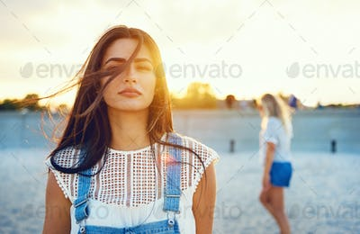 Wind blowing through hair of beautiful woman