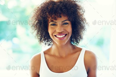 Happy curly woman.