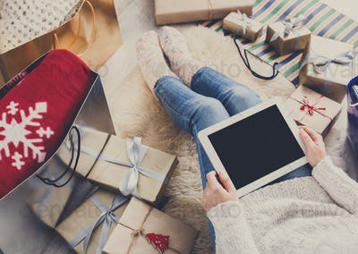 Woman christmas shopping online with tablet