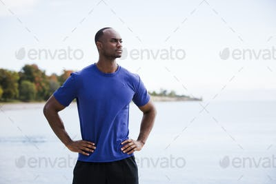 young fitness man on the beach