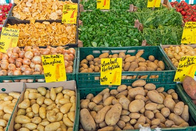 Potatoes and other vegetables at a market