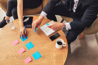 Two business colleagues preparing post it notes