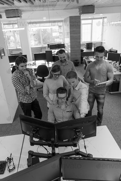 startup business people group working as team to find solution