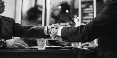 Businessmen Deal Handshake Agreement Concept