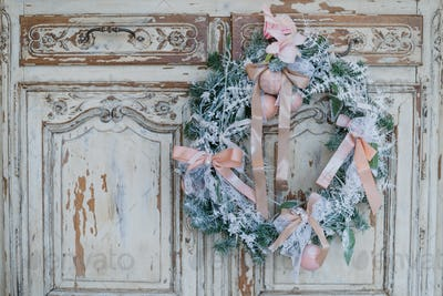 Christmas decoration on ancient vintage old commode chest of drawers.
