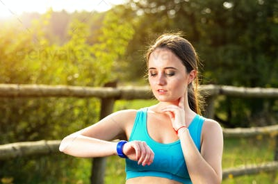 Woman using fitness bracelet