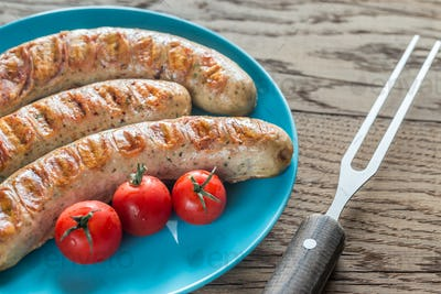 Grilled sausages with cherry tomatoes