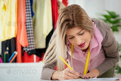 Fashion Designer With Sewing Pattern