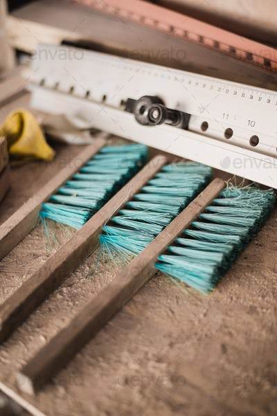 Wood carpentry tools at workshop. Brushes and ruler.