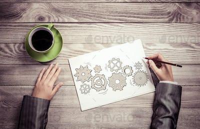 Businesswoman sketching teamwork concept