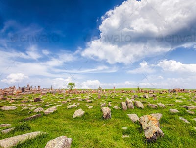 stones on lawn and magnificent cloudy sky