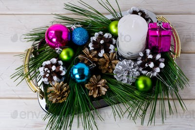 Christmas multicolored ornaments and candle centerpiece