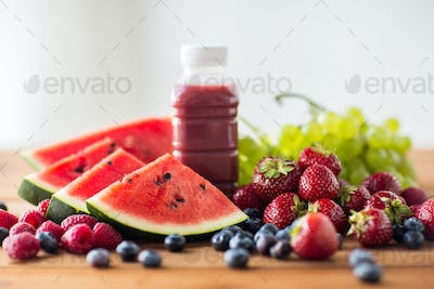 bottle with fruit and berry juice or smoothie