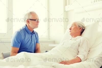 senior couple meeting at hospital ward