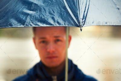 Man in rainy day