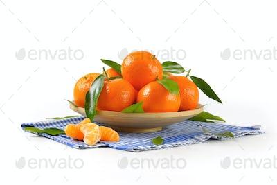plate of ripe tangerines