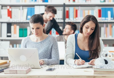 Young college students studying together