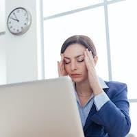 Businesswoman having an headache