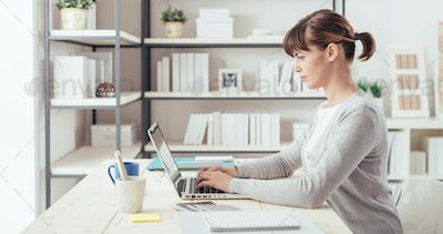 Young office worker working at desk