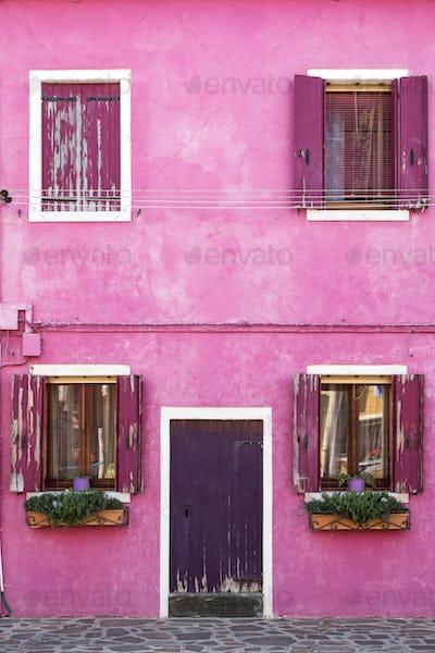 Architecture detail of colorful pink house on Burano island, Venice