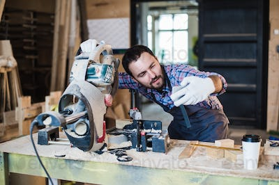 Carpenter taking a selfie with miter saw at his work place