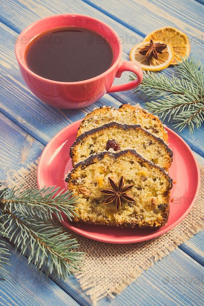 Vintage photo, Cup of coffee, fresh baked fruitcake for Christmas and spruce branches