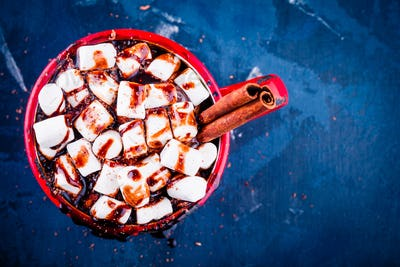 Hot cocoa with chocolate, marshmallow and cinnamon