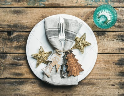 Christmas, New Year holiday table setting over wooden background