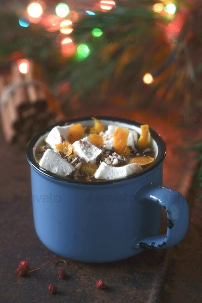 Hot chocolate with orange and marshmallows on the brown background  vertical