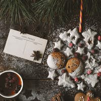 Christmas ball made by  cookies on the wooden background with different accessorizes vertical